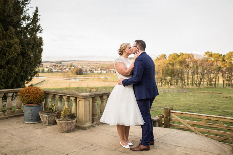 A romantic kiss at Kat and Alan's Woodhill Hall wedding