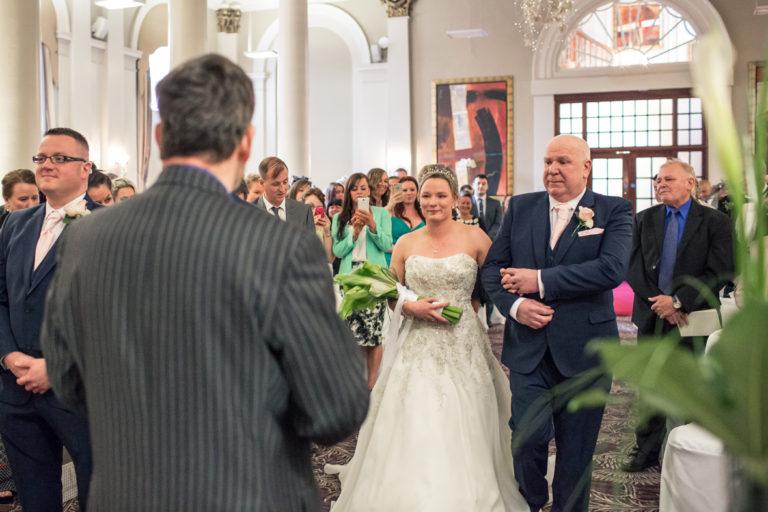 Lauren walking down the aisle at her George Hotel Edinburgh wedding