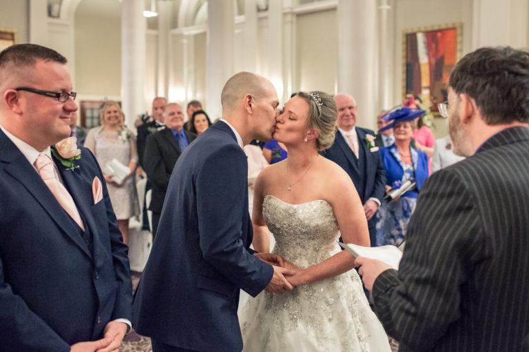 Lauren and Jason's first kiss at their George Hotel Edinburgh wedding